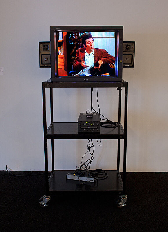TV with an image on a stand.