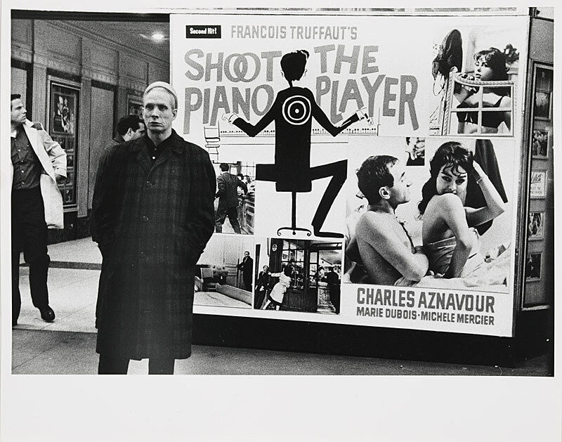 Man standing in front of poster.
