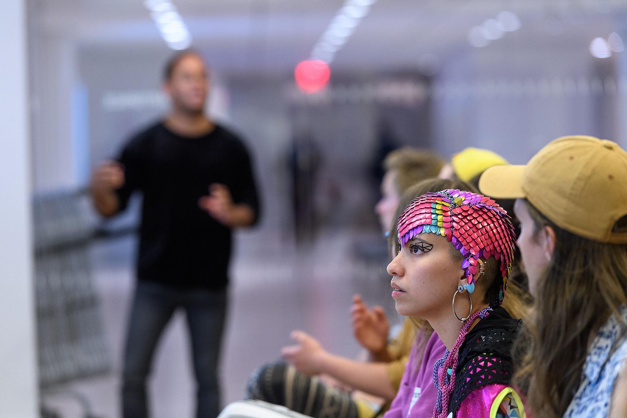 Attendees listen to a presentation.