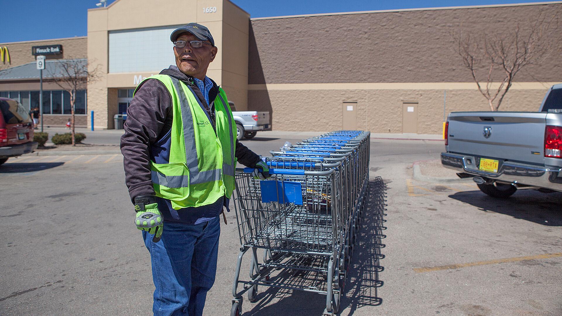 Man pushing shopping carts.