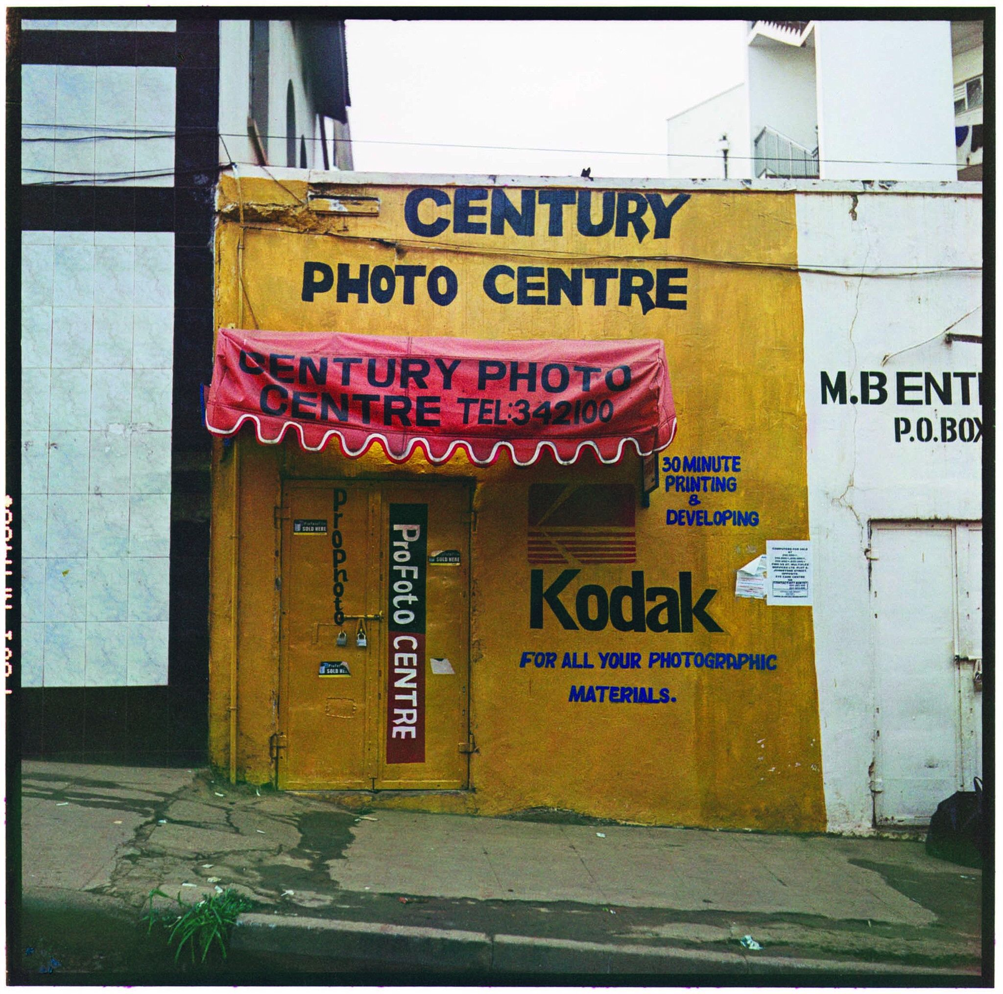 Photograph of a yellow photography store.