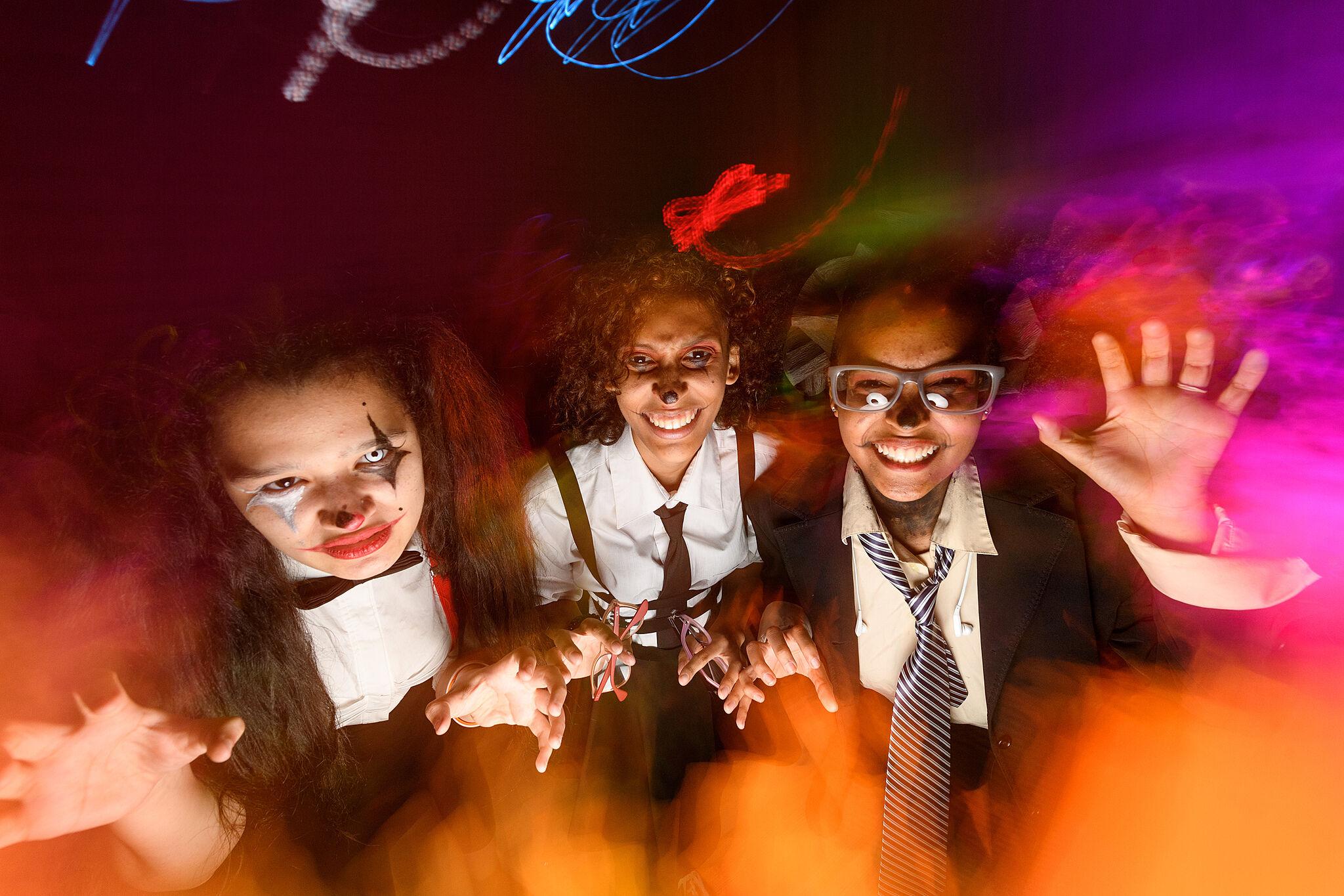Teens in costume.