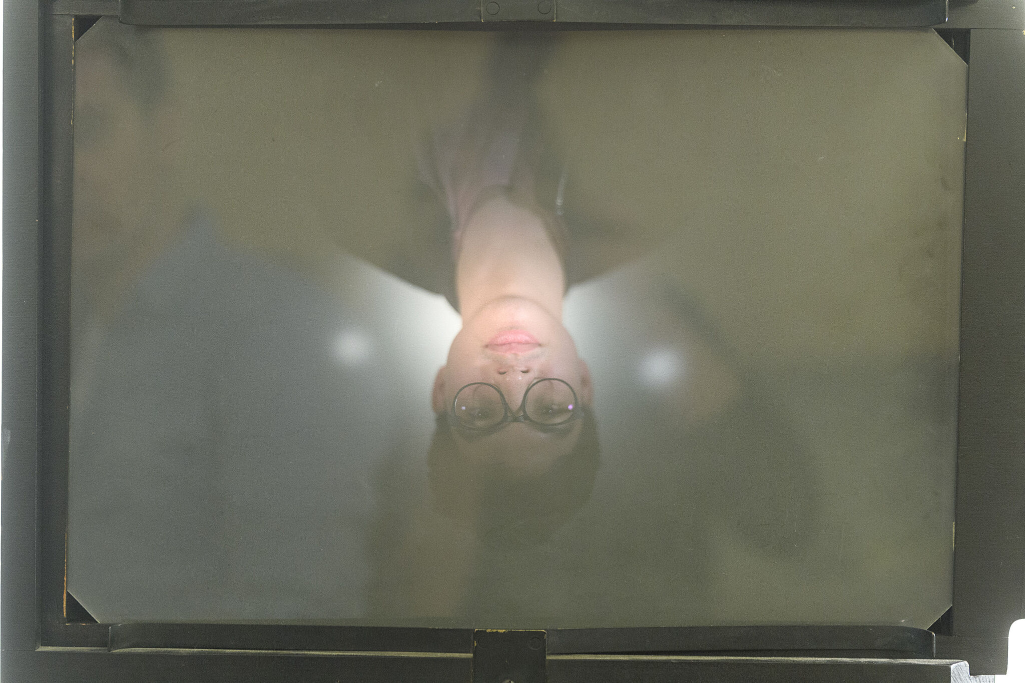 Upside down portrait.