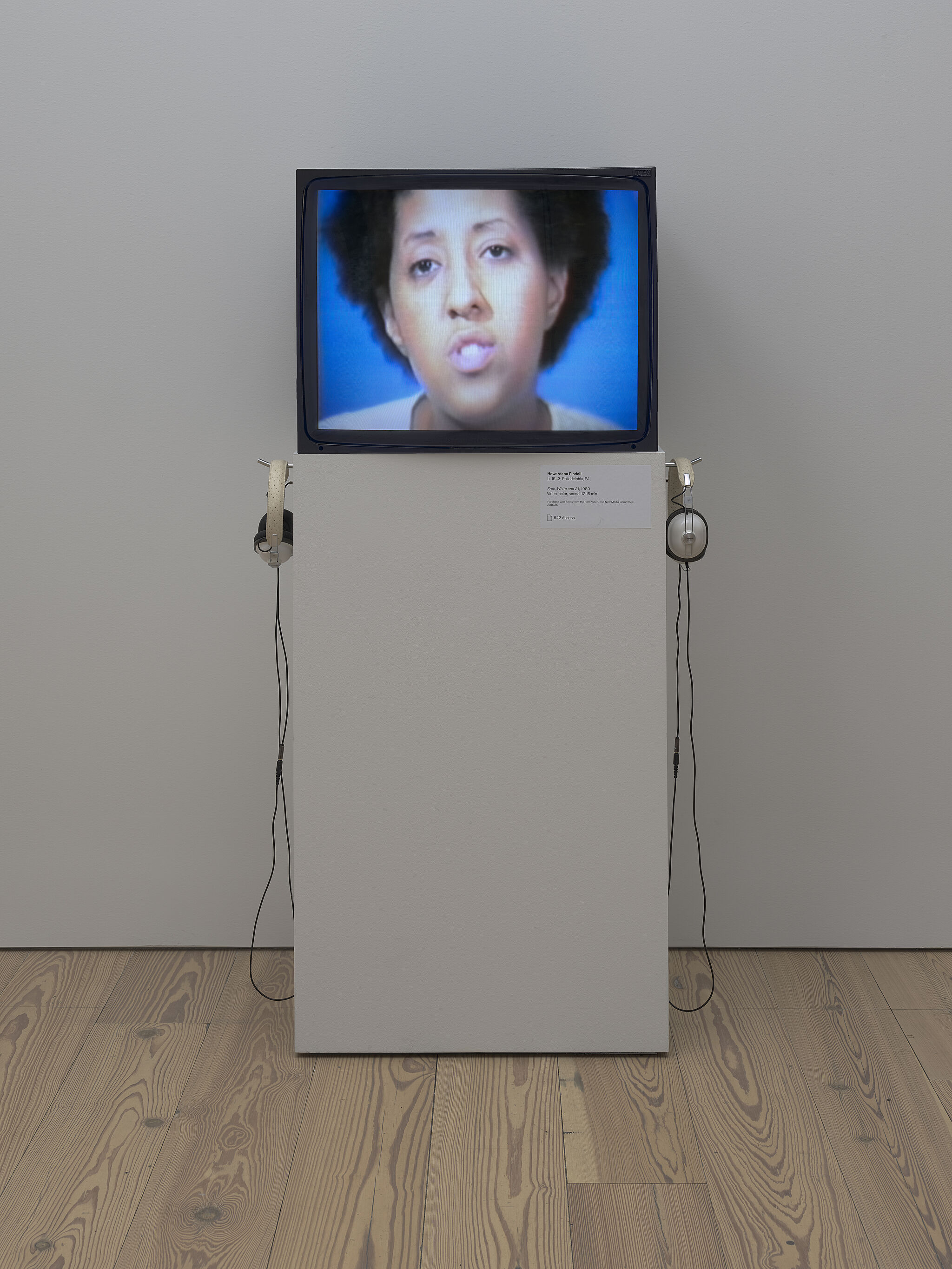 Image of a TV with a still of a woman's face.