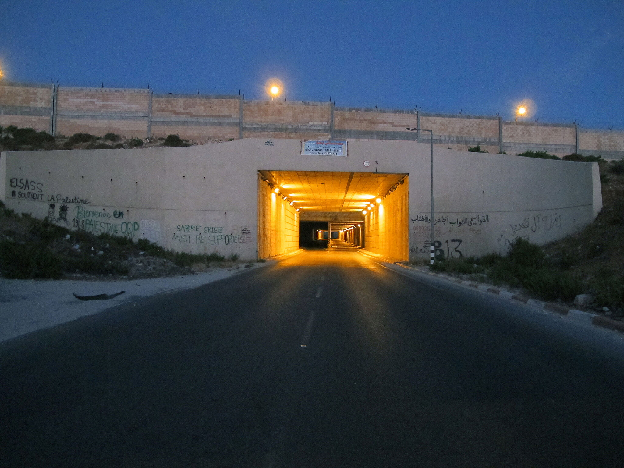Tunnel at night with light.