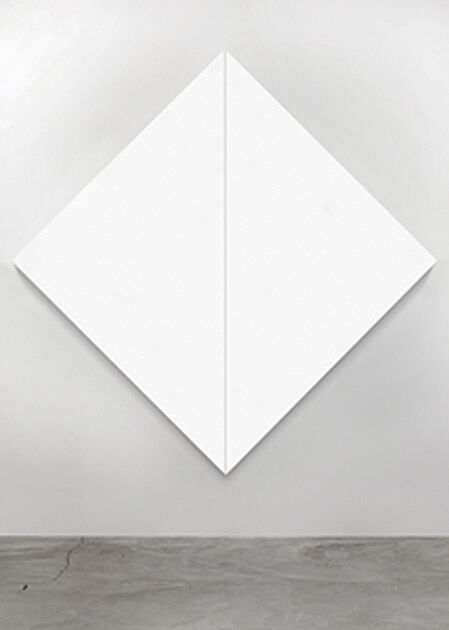 Two triangle-shaped white canvases.
