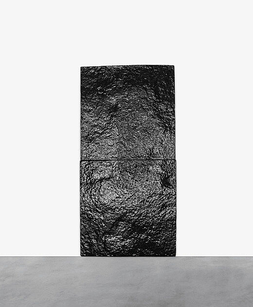 Black textured rectangular artwork.