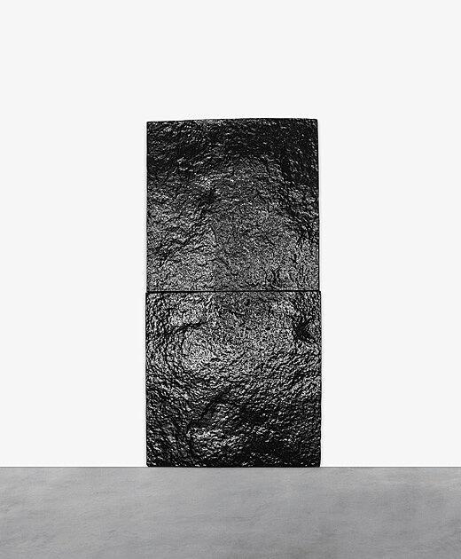 Black textured rectangular artwork.