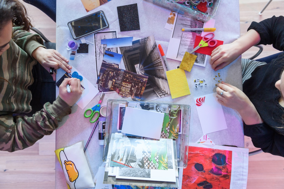 Teens participating in a postcard-making activity.
