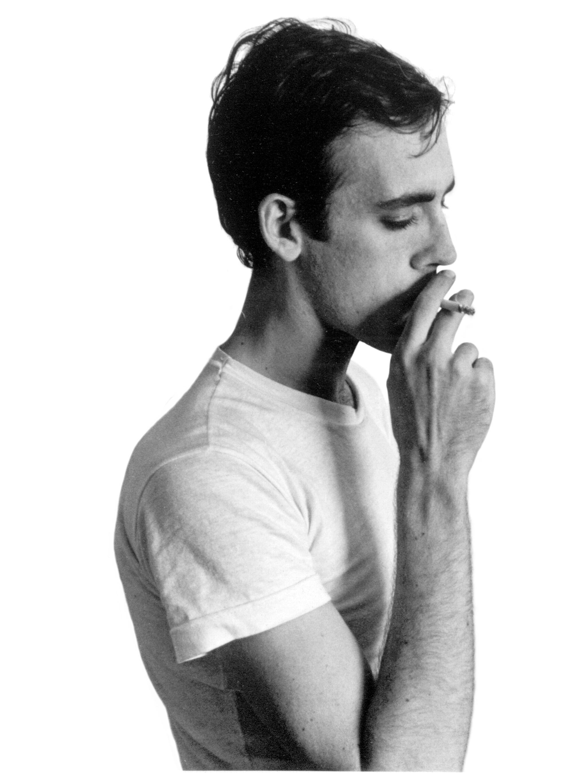 David Wojnarowicz smoking a cigarette.