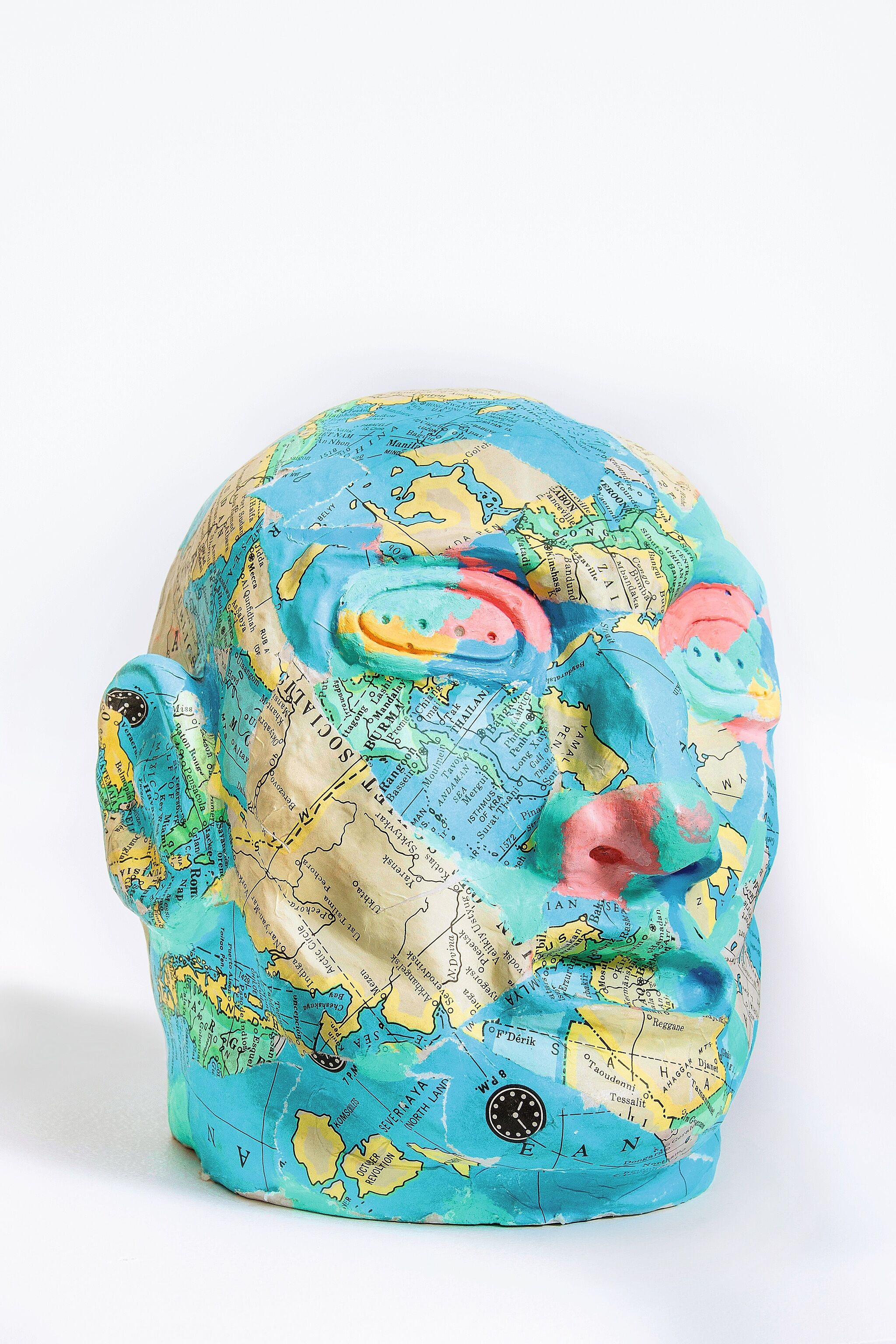 A sculpture of a head made out of maps.
