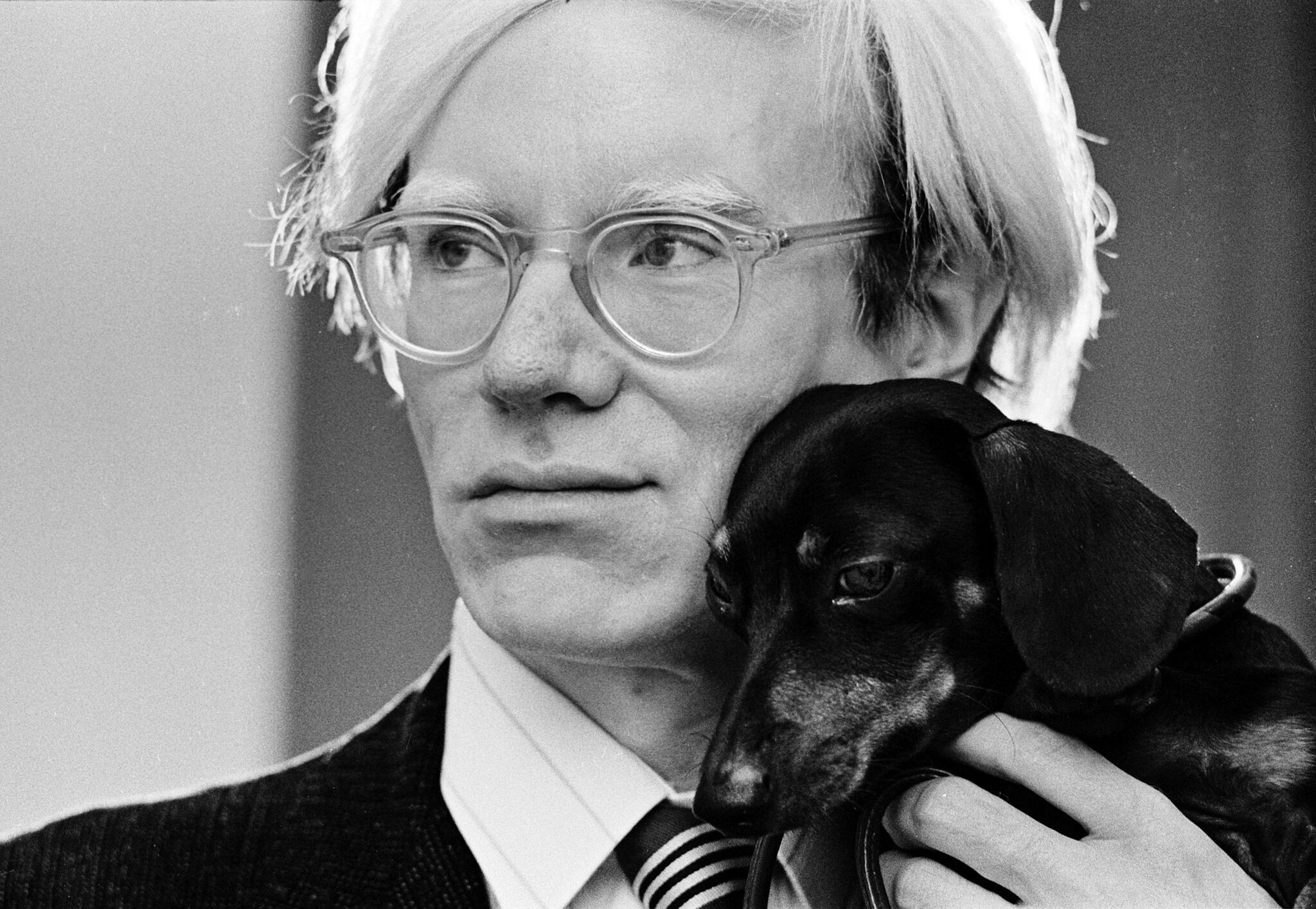 Andy Warhol and his dog Archie.