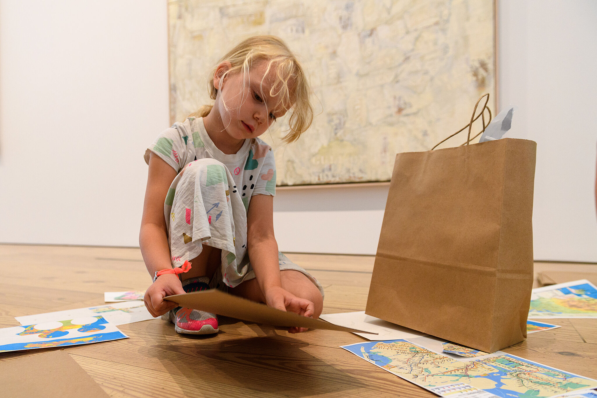 A kid doing an activity in the galleries.