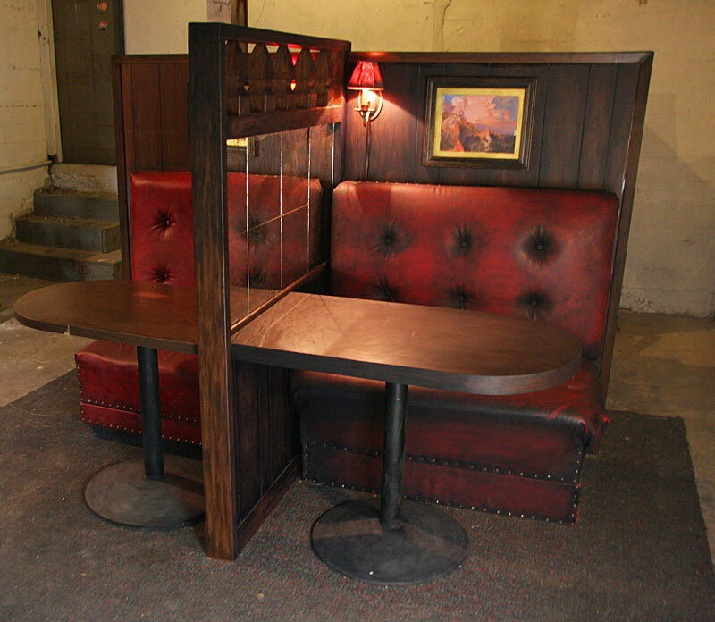 two booths in a dark bar.