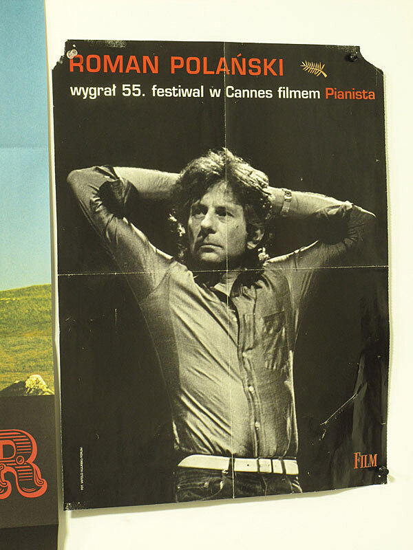 A poster of a man.