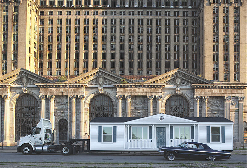 A mobile homestead in front of a building.