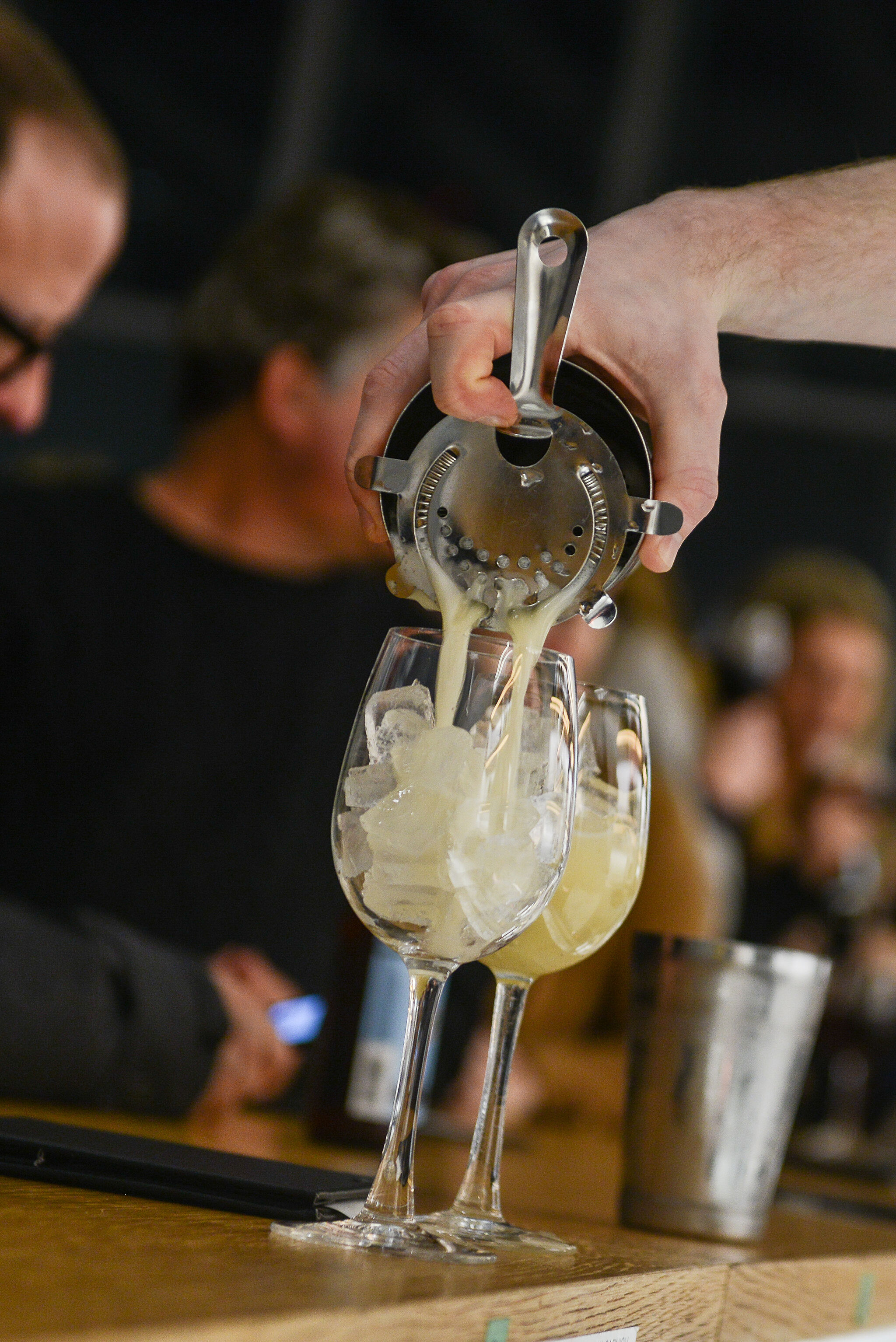 A close-up photo depicting a drink being poured.