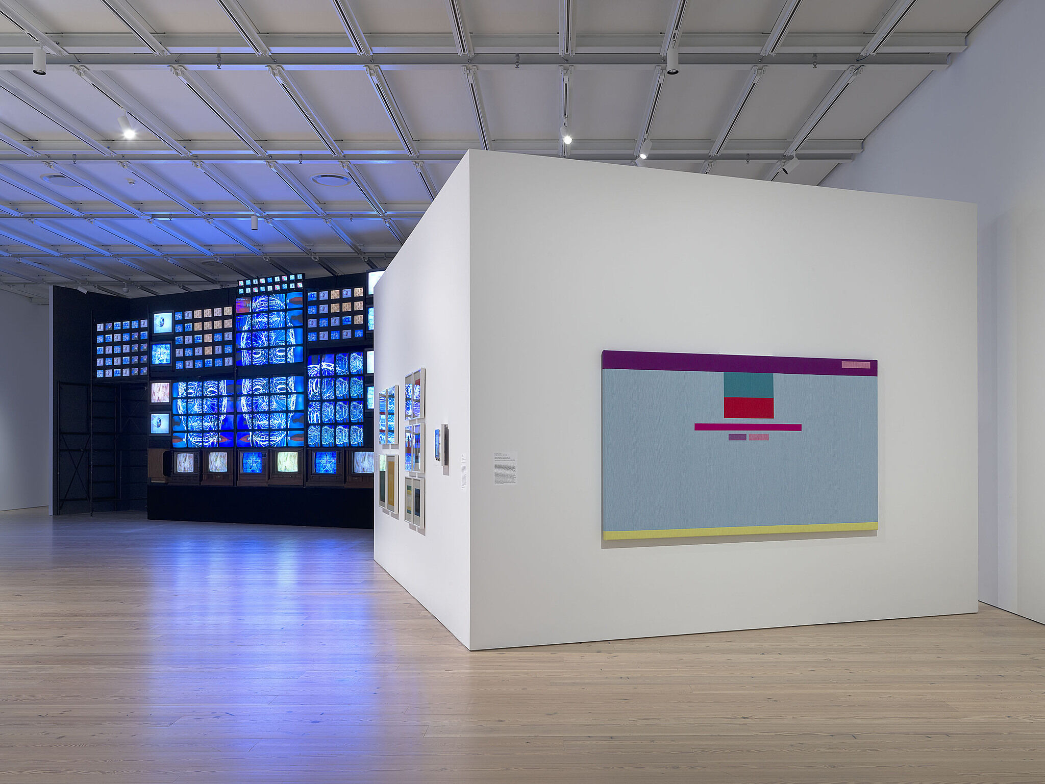 A photo of the Whitney galleries with various artworks.