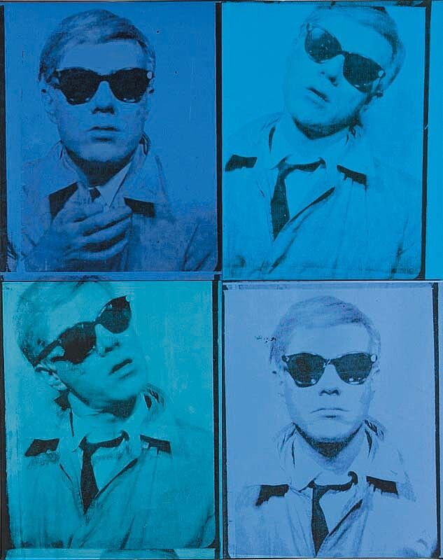 A block of four, blue tinted self portraits, by Andy Warhol