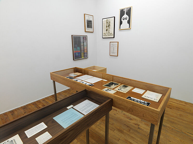An installation view of photographs and letters.