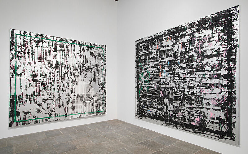 An installation view of two paintings.
