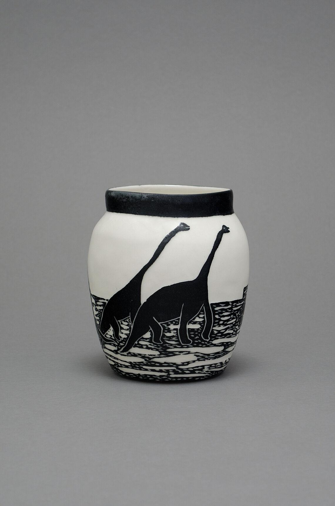 A porcelain pot of black and white dinosaur paint