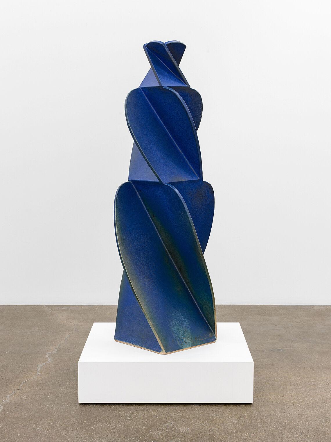 A tall blue ceramic artwork.