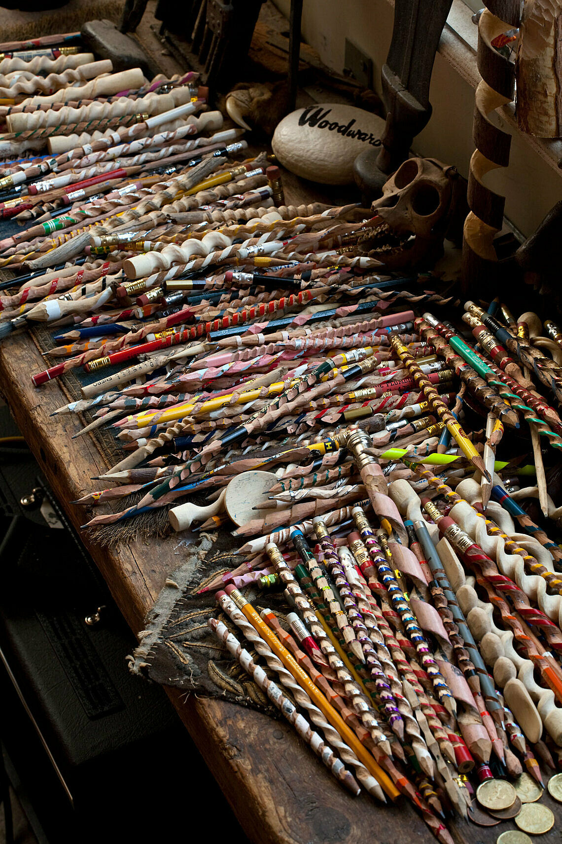 Many carved and colored pencils and sticks.