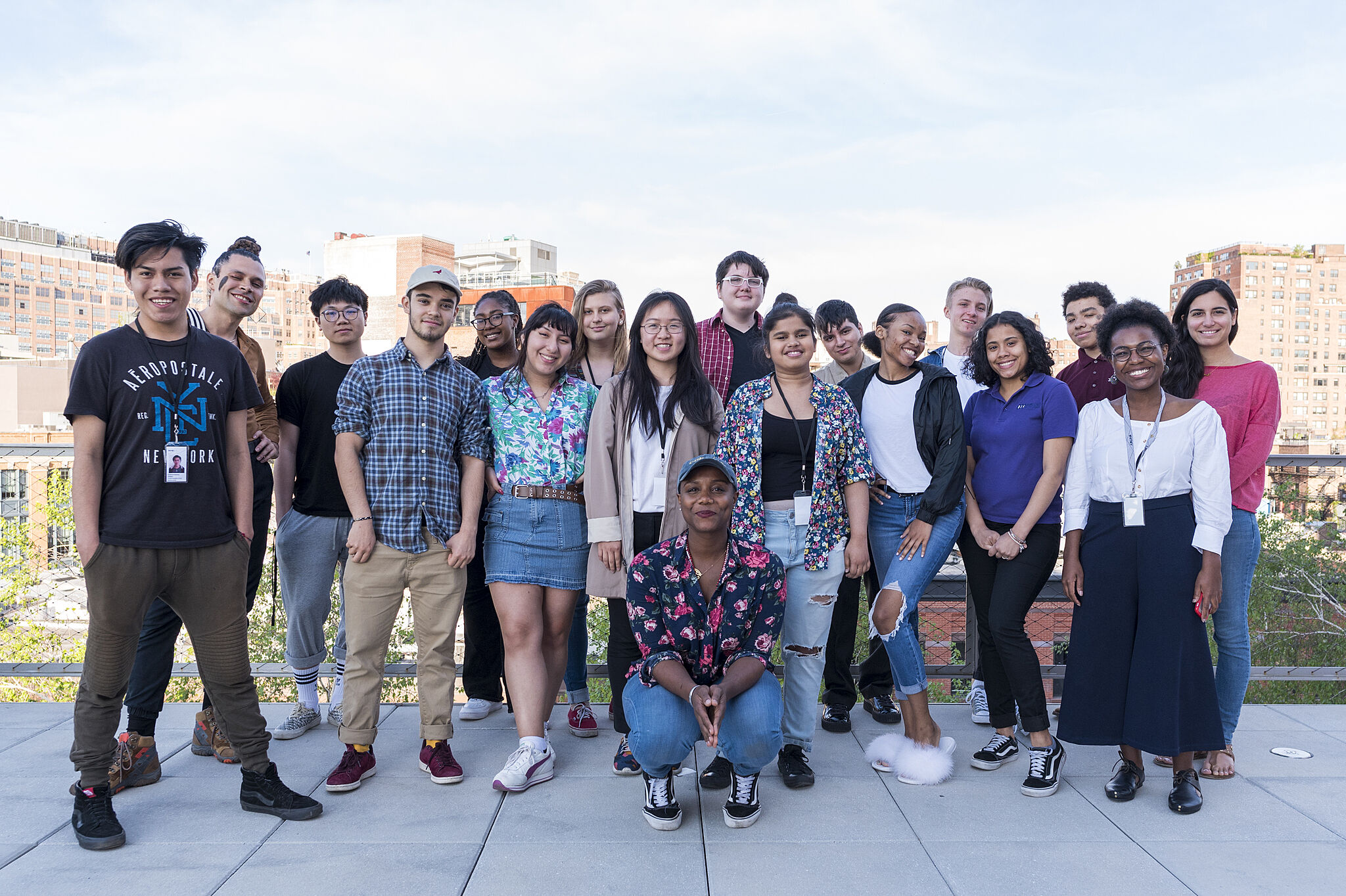 A group of teens standing with artist Ja'Tovia Gary.