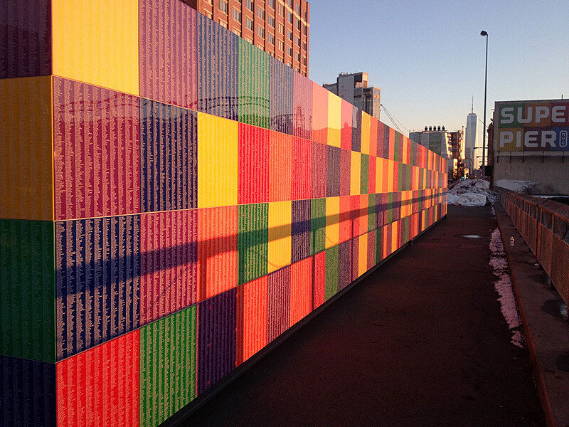 Installation view of many multicolored acrylic panels.