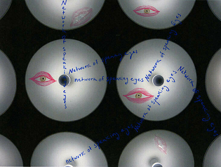 Round lights with eye-shape images on.