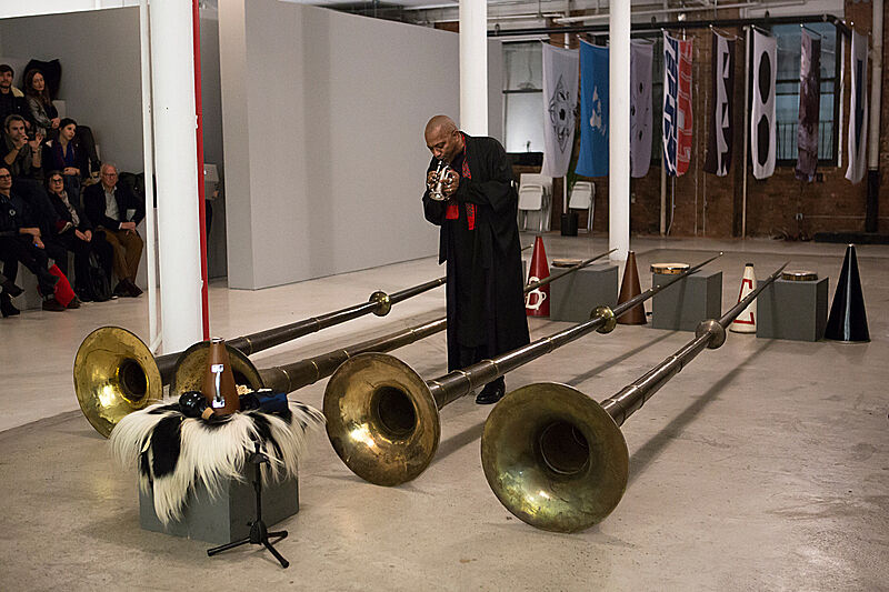 A person performing a trumpet.