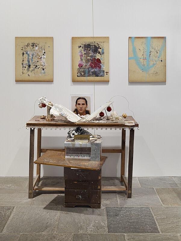 Installation view of artworks on the wall and on the table.