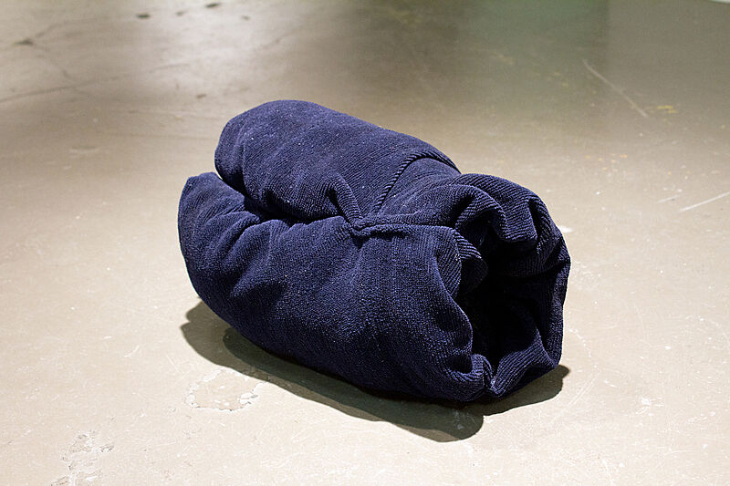 A rolled blue towel.
