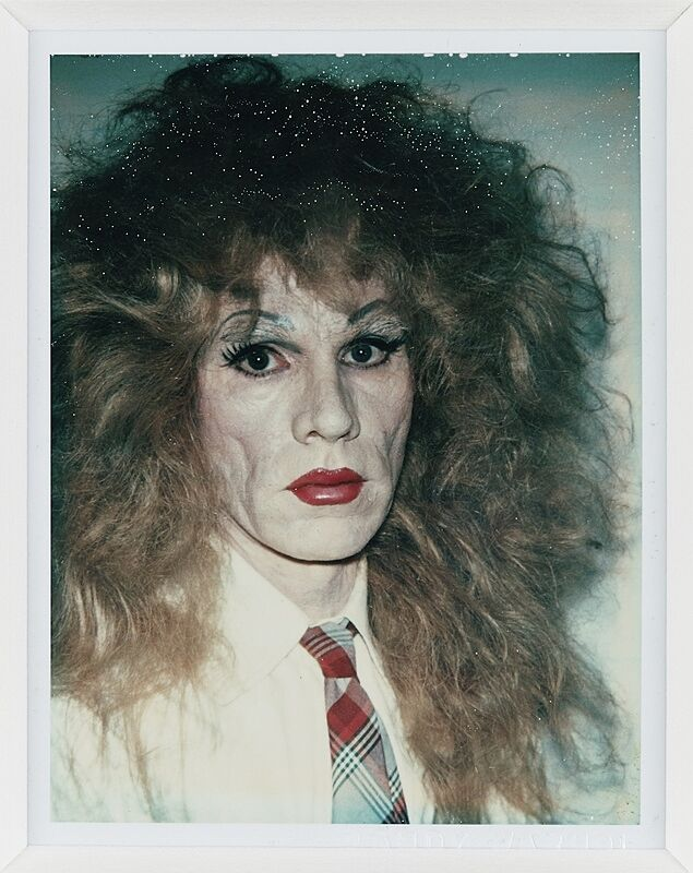 A self portrait of Andy Warhol in drag.