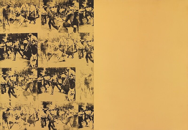 An image of a race riot printed on yellow canvas.