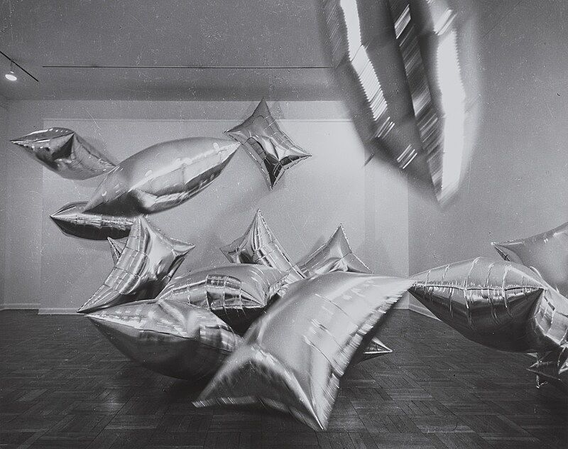 Silver balloons in a room.