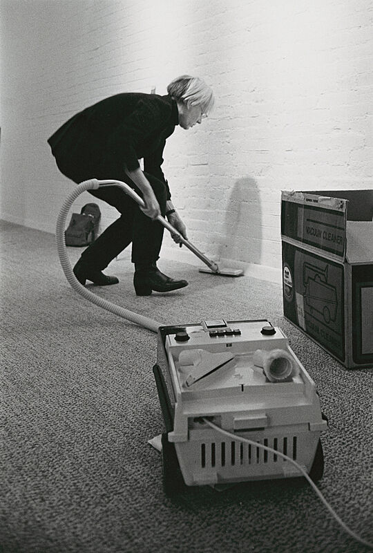 Warhol vacuuming an empty gallery.