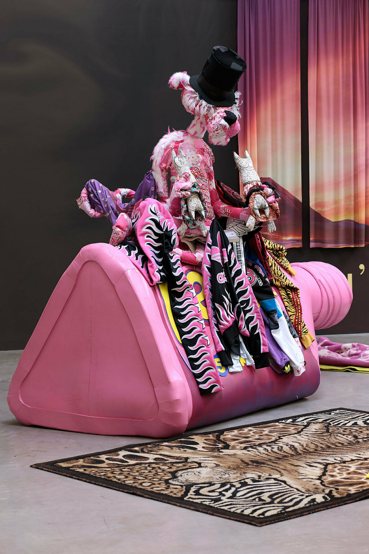 A cartoon model of a pink panther sitting on a pink triangle sofa.