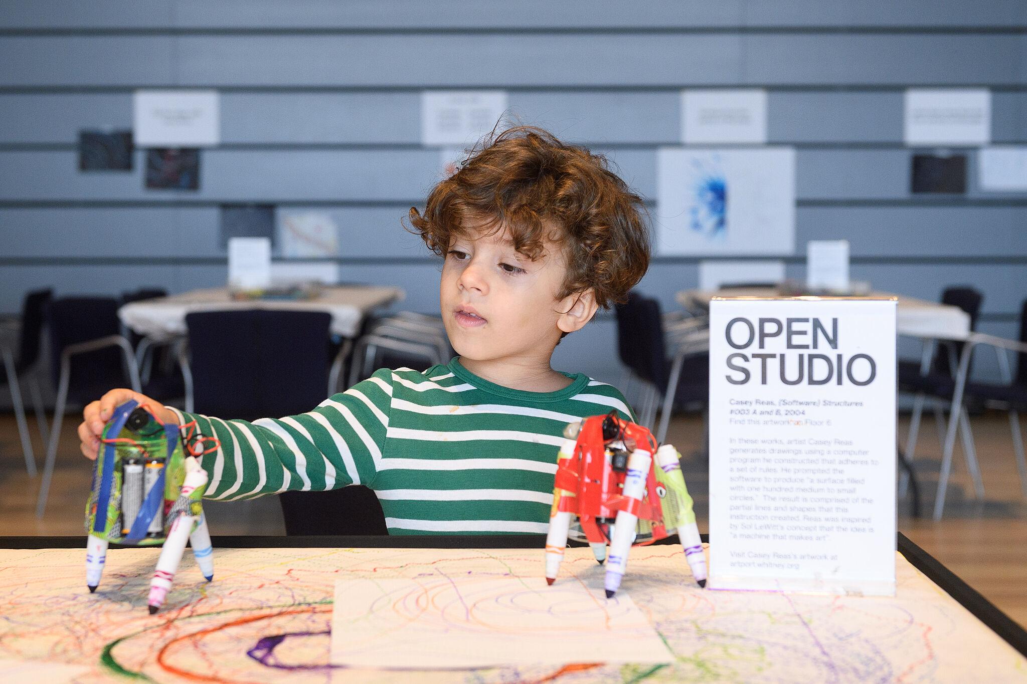 A child making art in Open Studio.