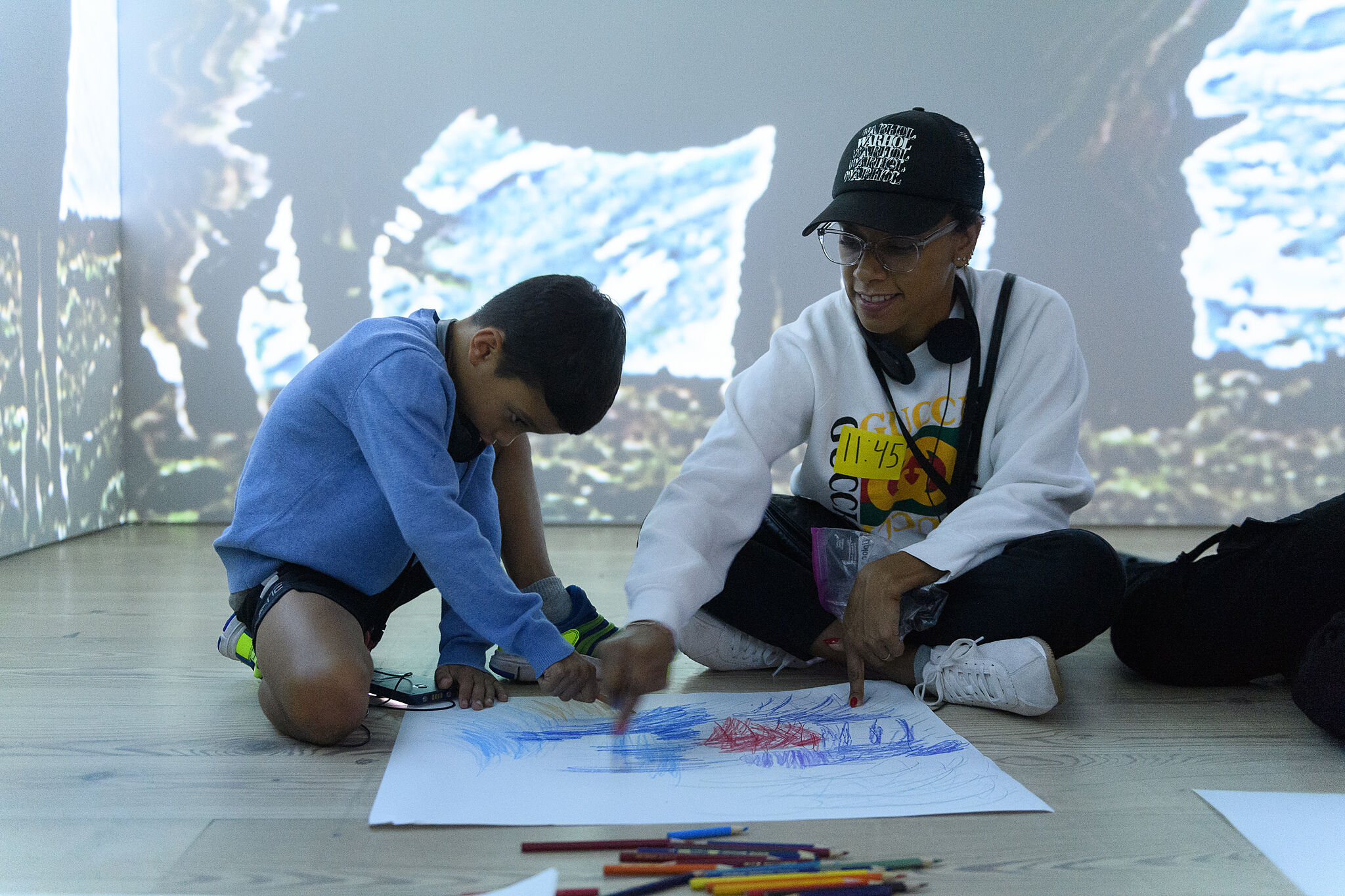 Families making art together in the galleries.
