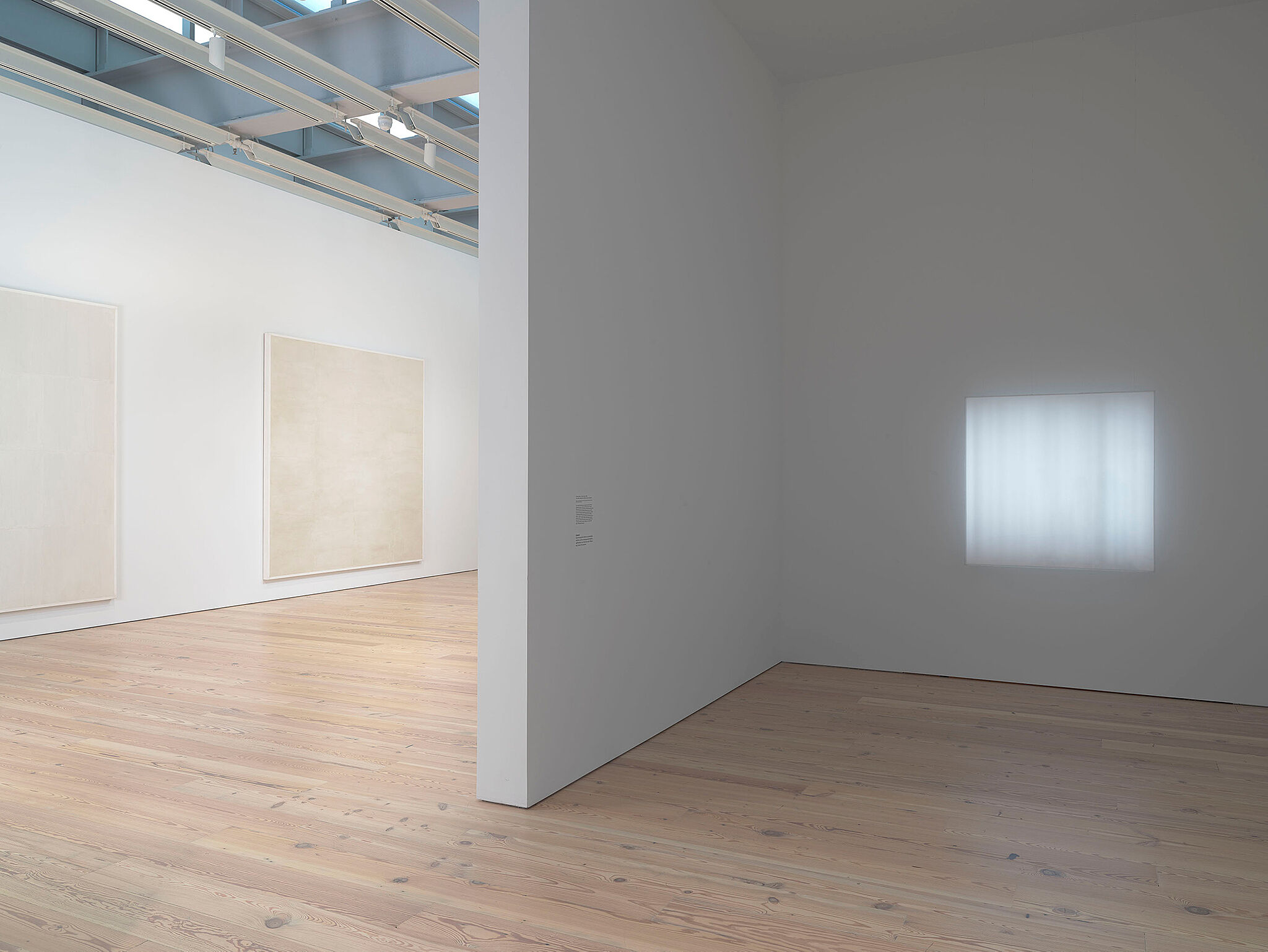 Installation view of Mary Corse works at the Whitney Museum