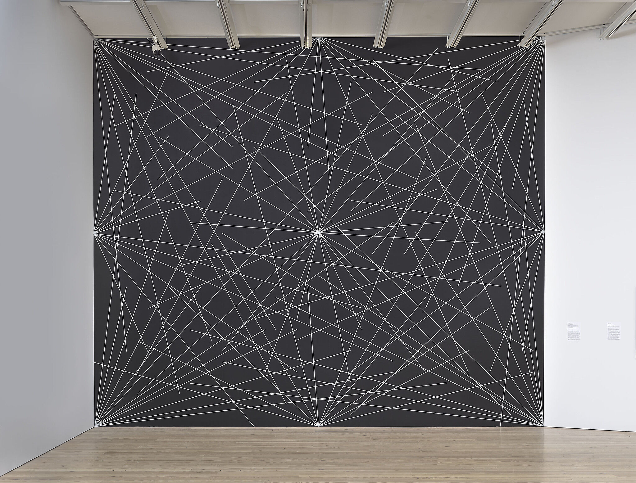 A black wall with white drawn lines.