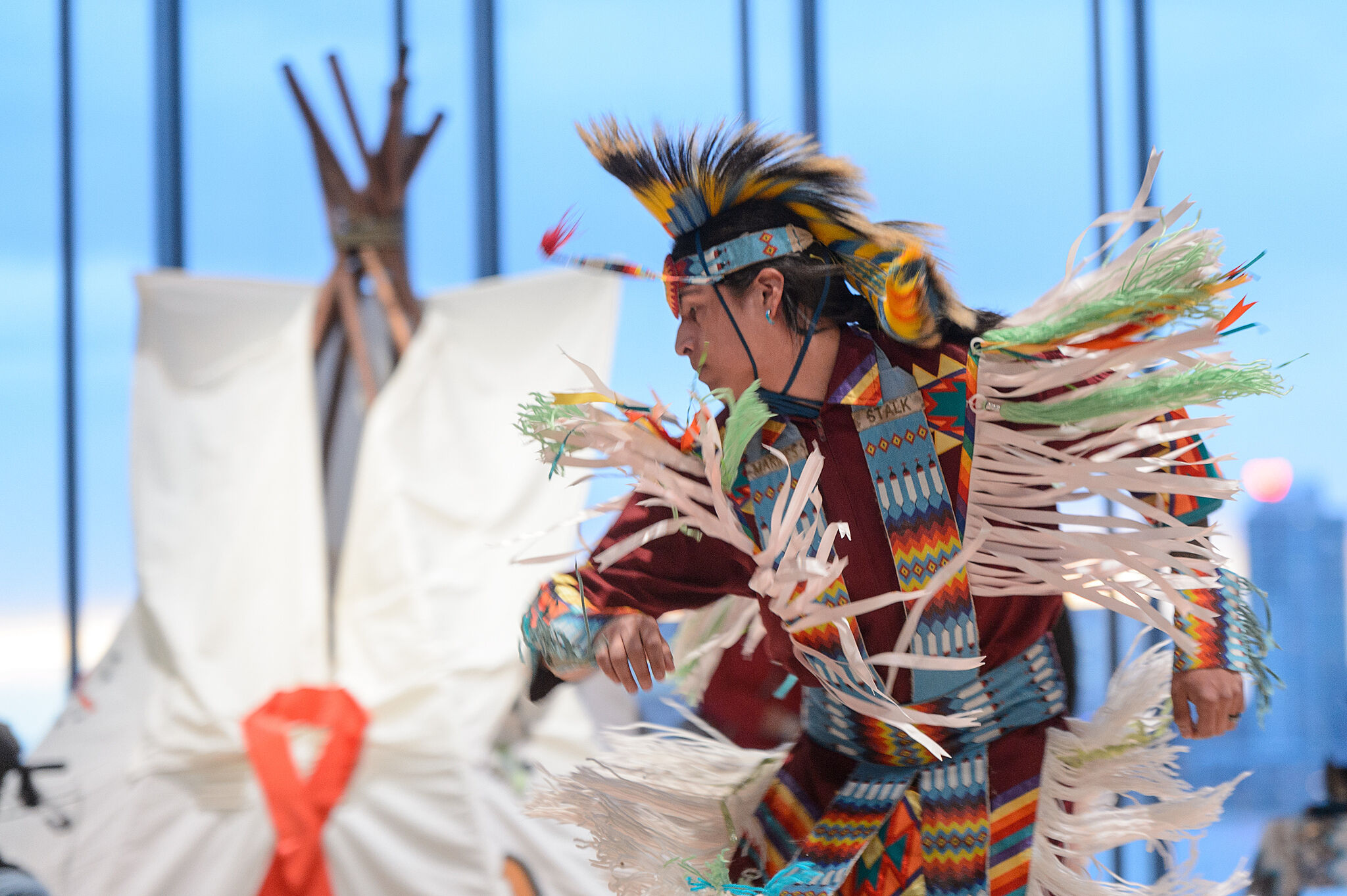 A photo of a Native American performer dancing