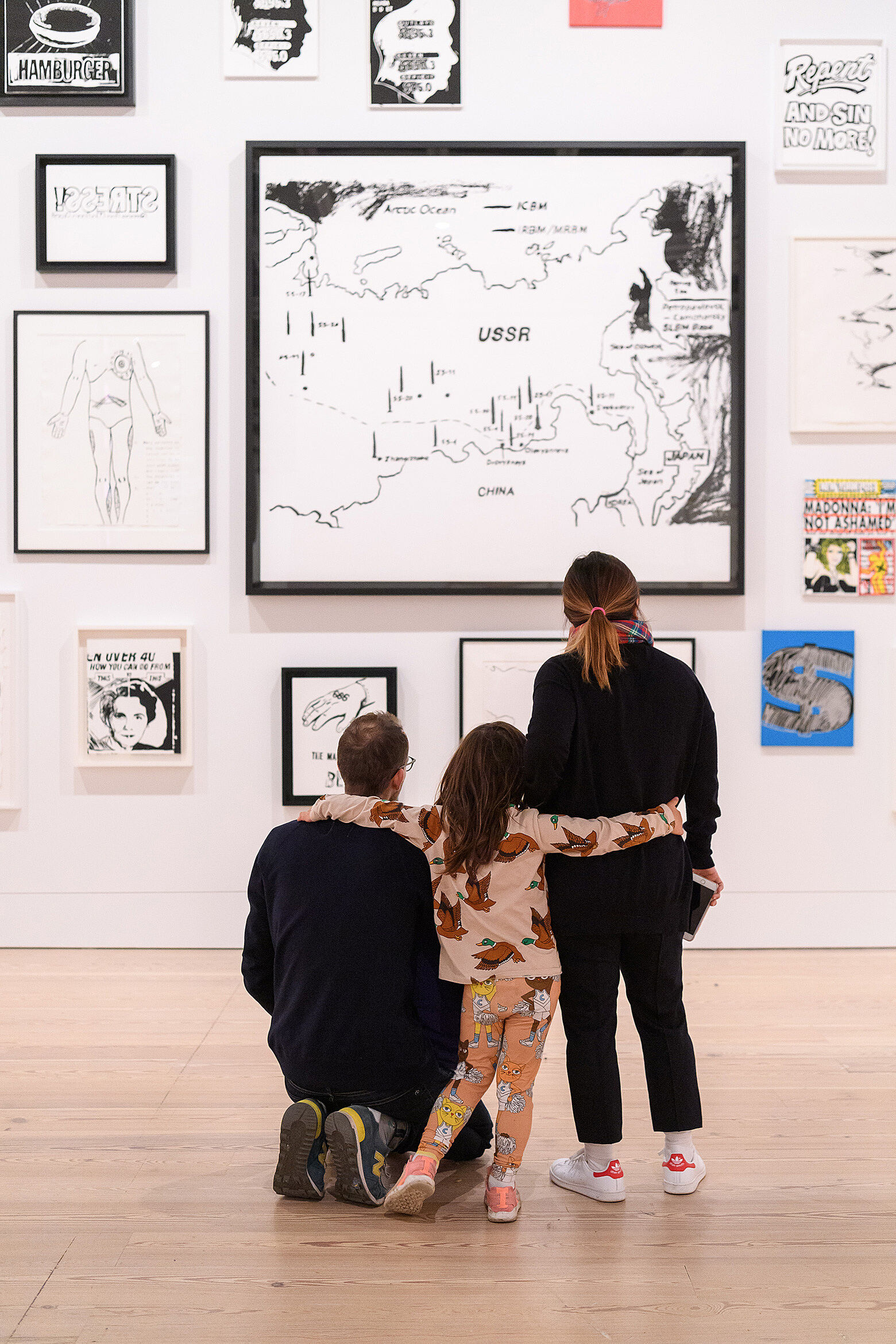 Families exploring the galleries at the Whitney