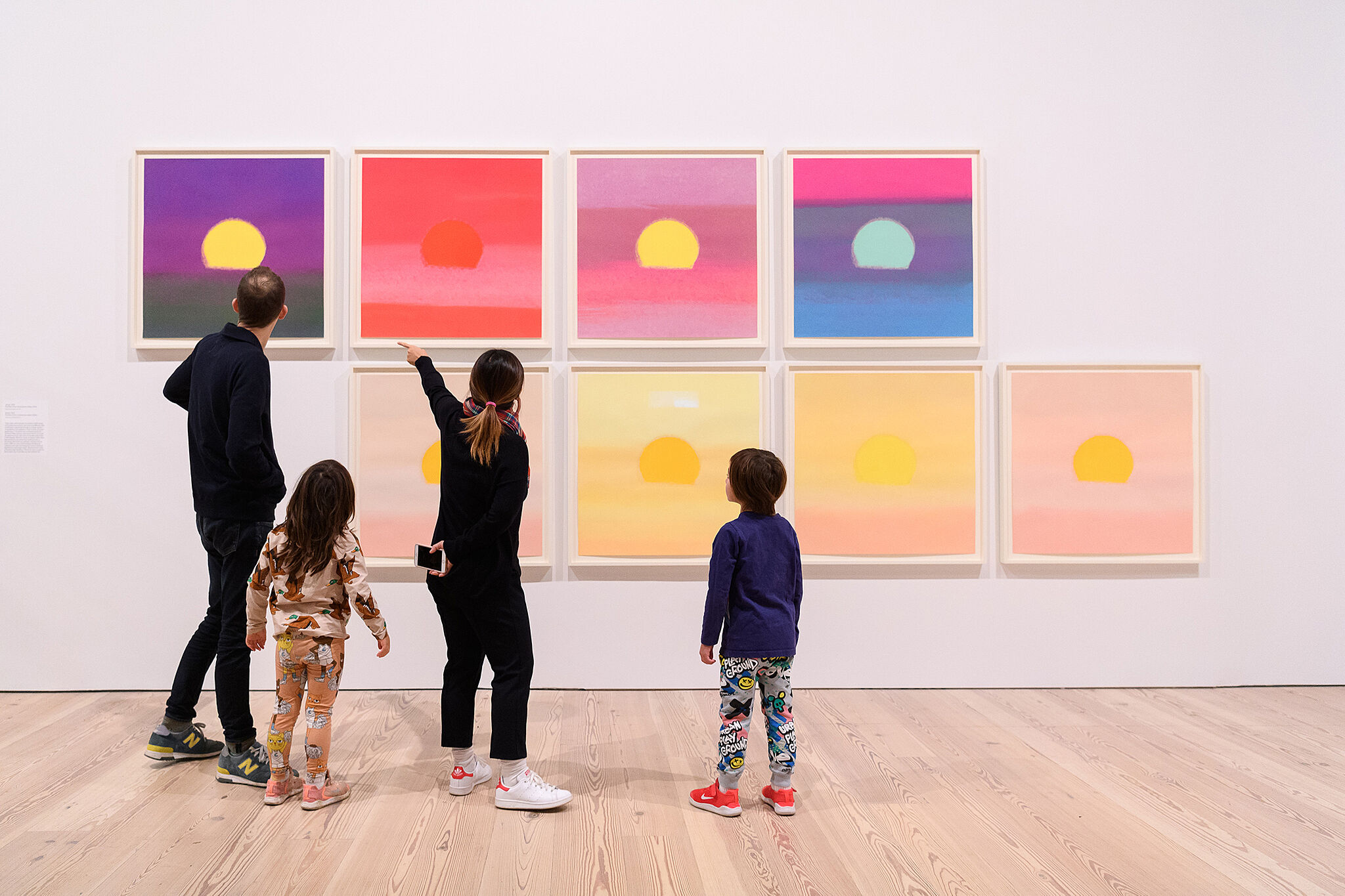 Families look at art together