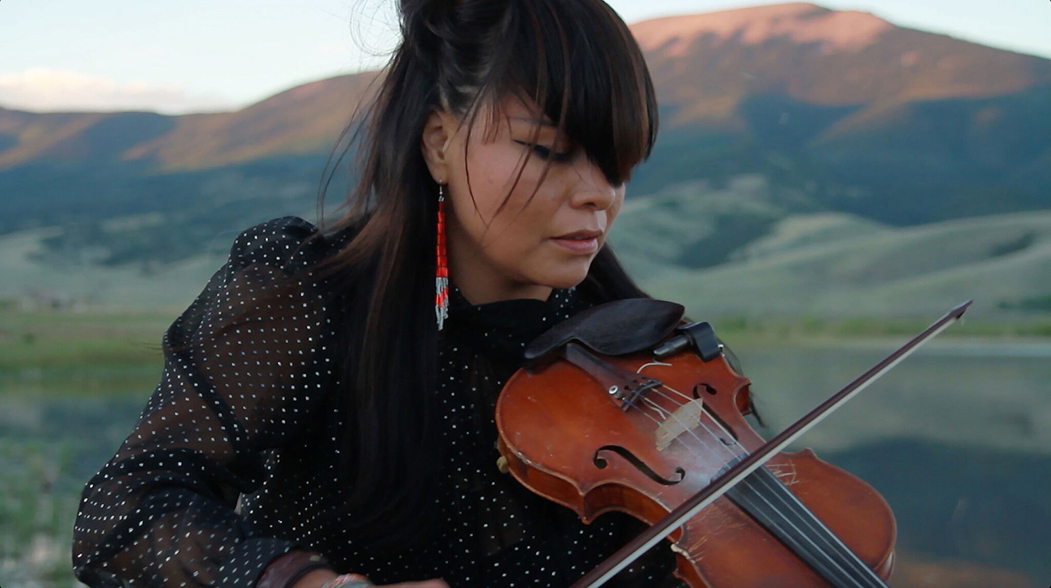 A photograph of a woman playing violin