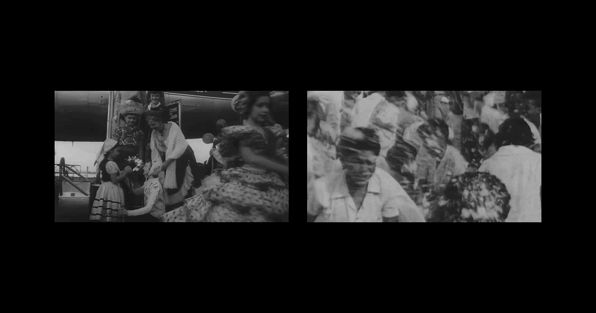A black-and-white video still of a split screen with one side featuring people standing on the stairway to a plane and the other featuring a blurry crowd of people.