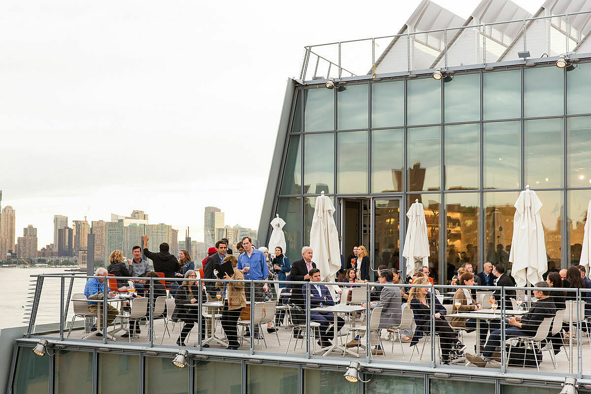 Visitors dine on the Studio Cafe rooftop.