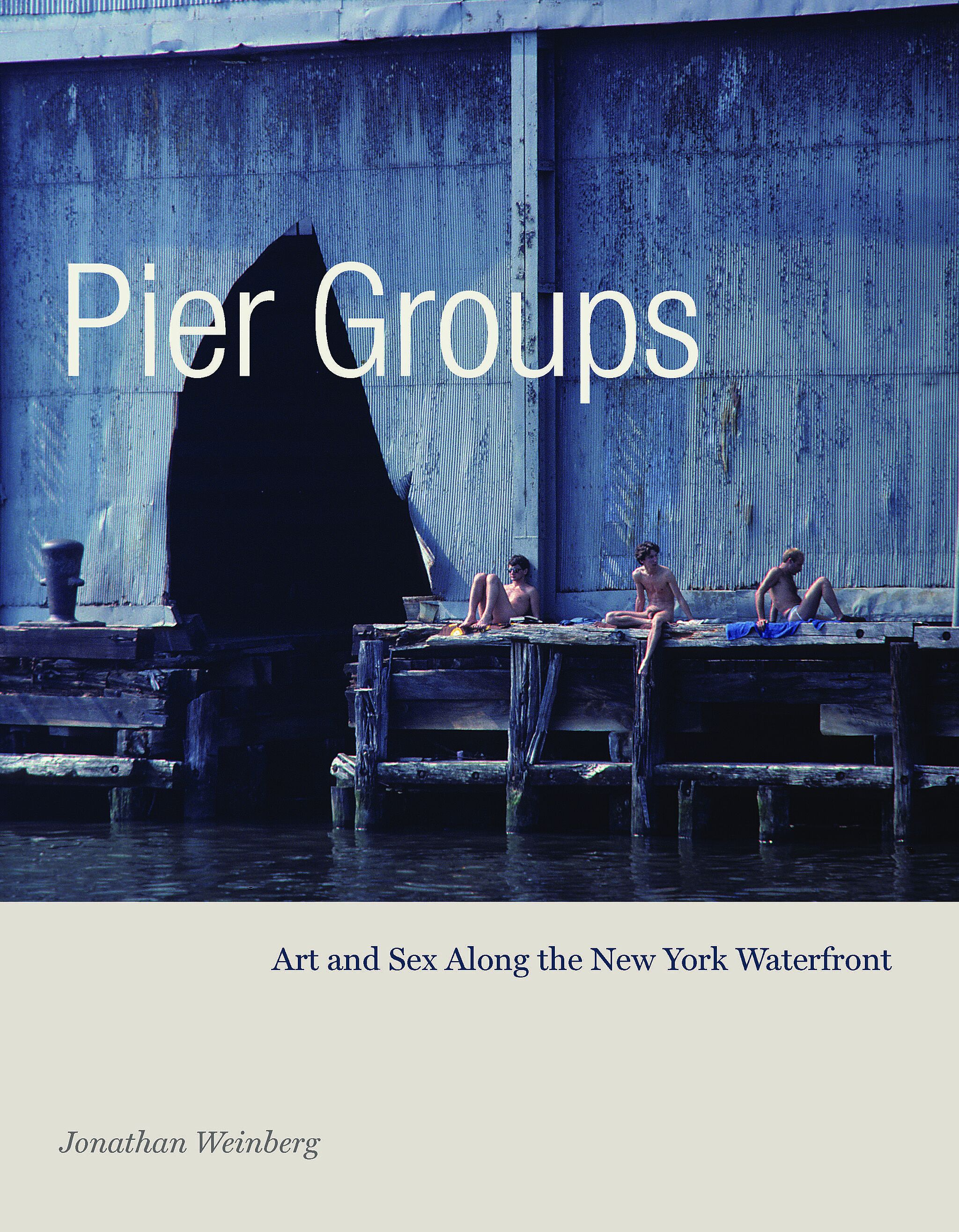 A book cover of three men sitting on the edge of a pier.